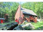 Well maintained classic chalet on over 1 acre