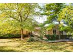 Serene one-of-a-kind ranch home sitting on 1.4 acres!