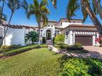 Naples Five BR 5.5 BA, This light and airy residence is located