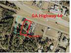 Kingsland, one acre commercial parcel with utilities in
